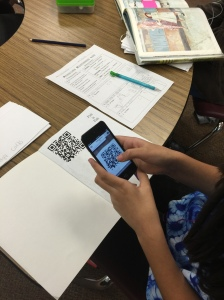 Student scanning the QR code for the listening station.